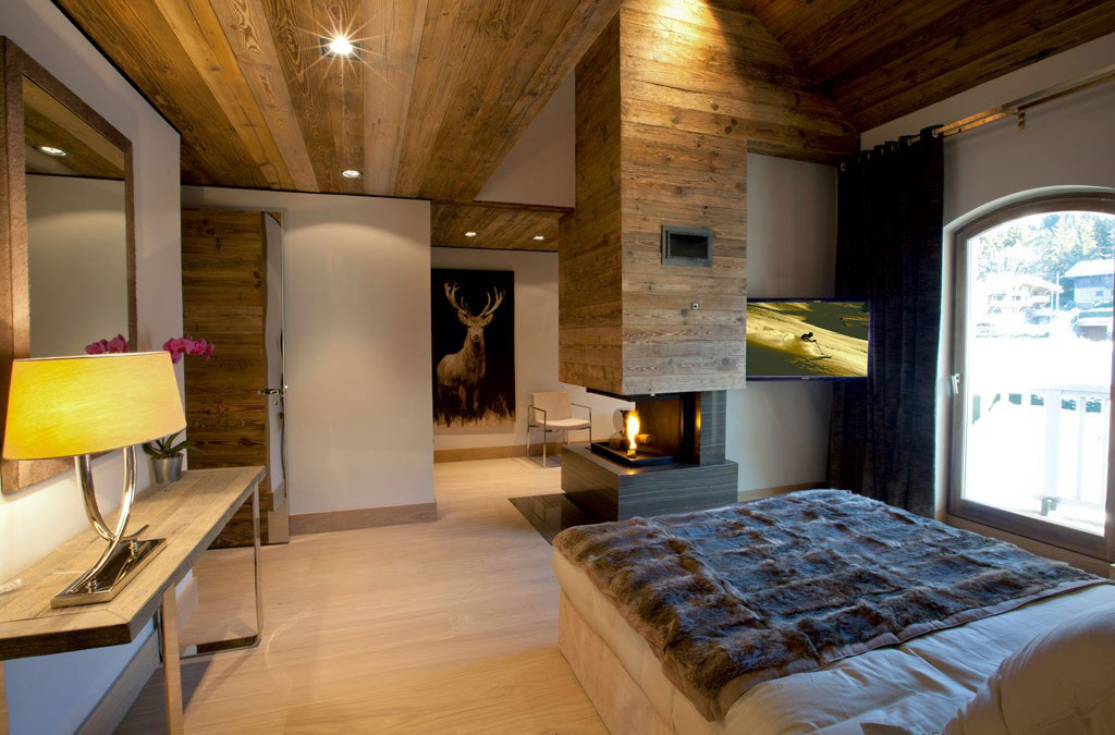 bedroom-rustic-modern-apartment-design-with-desk-table-lamp-wood-wall-panels-and-ceiling-fireplace-in-the-middle-plus-oak-wooden-floor-tiles