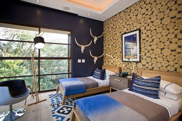 rustic-bedroom-with-attactive-wall-contains-of-twin-beds-with-wooden-bedstead-and-cozy-bed-in-white-sheet-and-blue-grey-bed-cover-rustic-floor-standing-lamp-and-dark-blue-chair